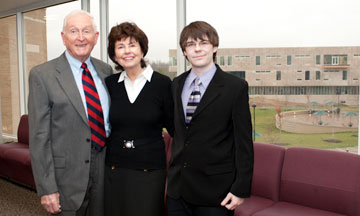 Image is of Bill & Helen Sands with Devin Burke
