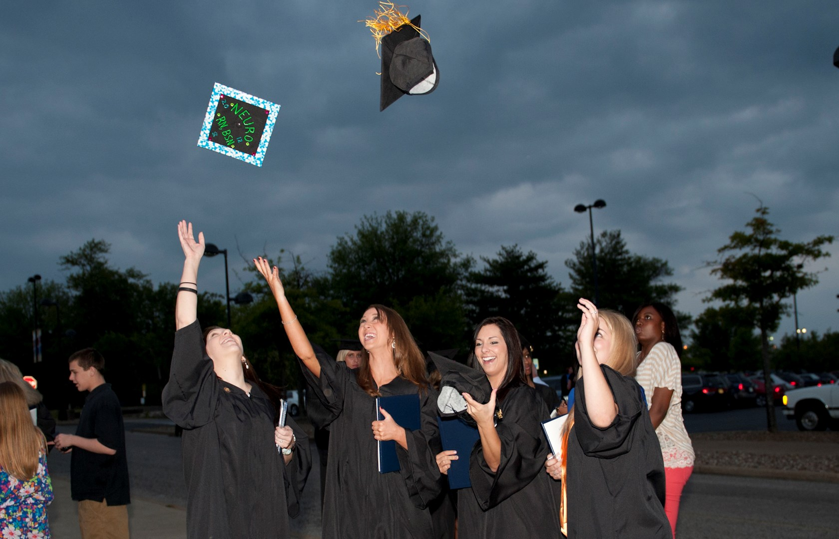 horiz females throw hats from graduation