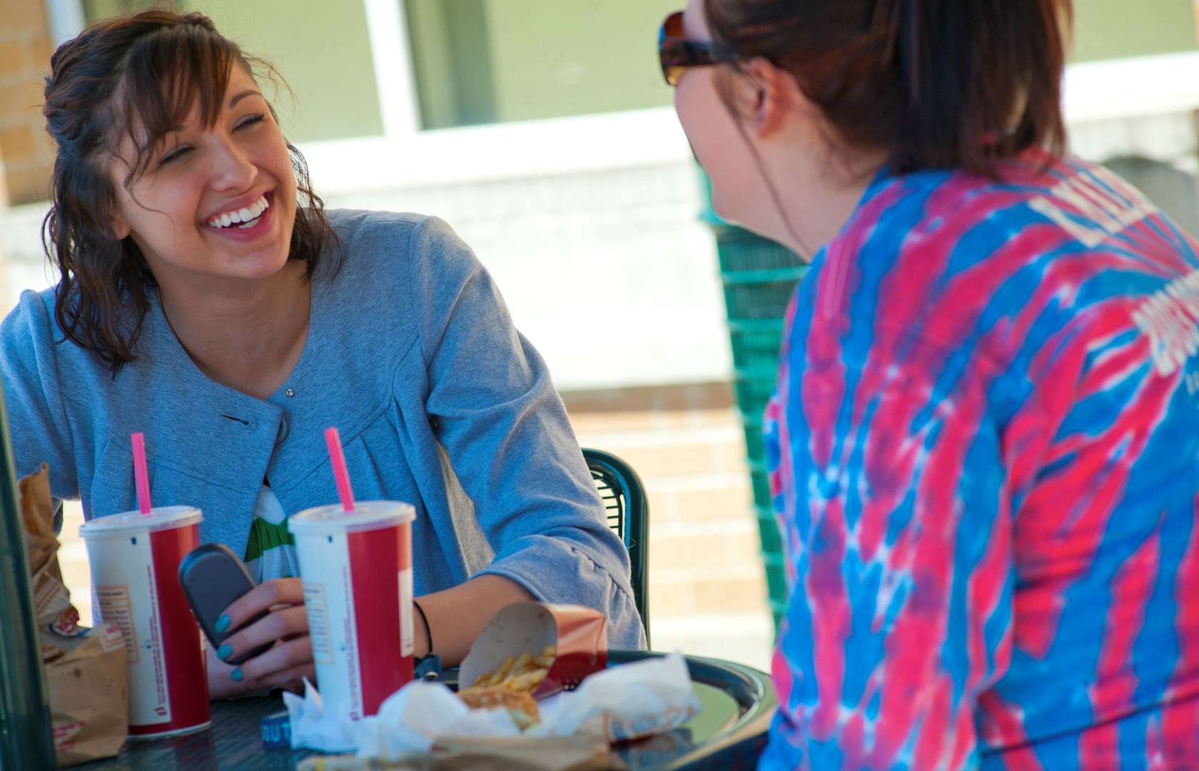 horiz females laughing during at lunch