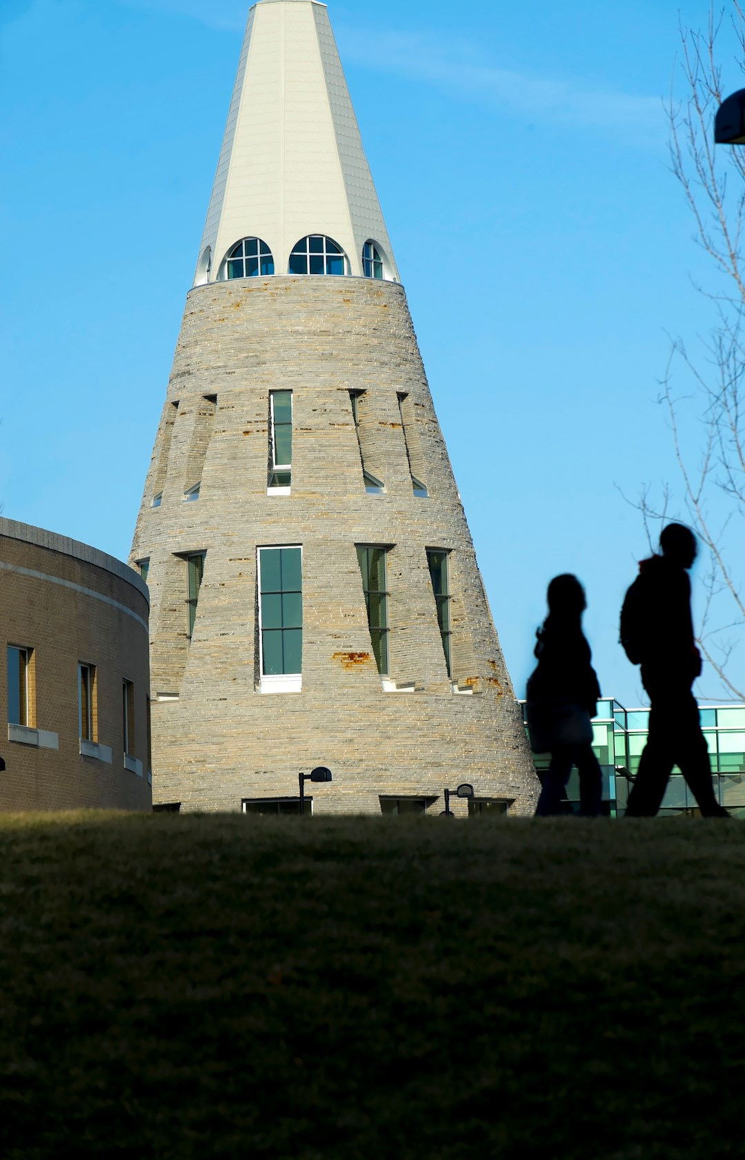 vert_student silhouetted with UC cone