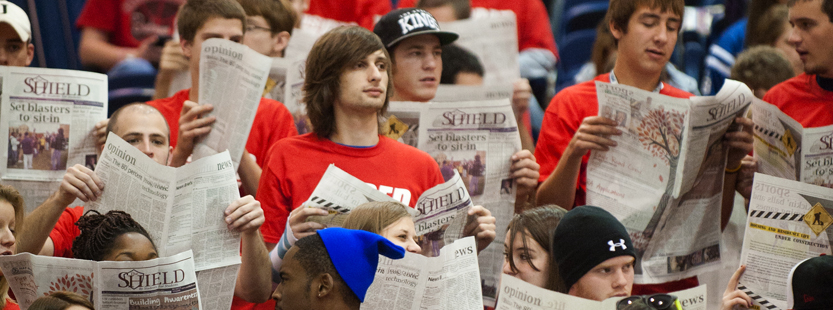 Communications students reading the student newspaper The Shield