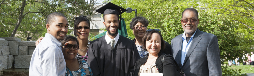 Multicultural center graduate with family