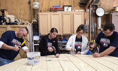Members of USI's Veteran Support Services gather at the Habitat for Humanity warehouse last Tuesday to construct yard barns for rehabilitated homes on the southeast side of Evansville.
