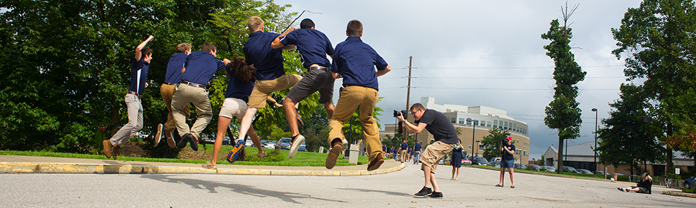 Resident Assistants jumping for joy at the start of school
