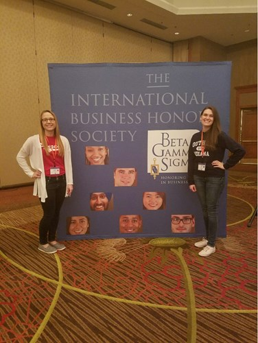 Senior accounting major Julia Russ, on right, represents USI Romain College at the 2016 BGS Global Leadership Conference