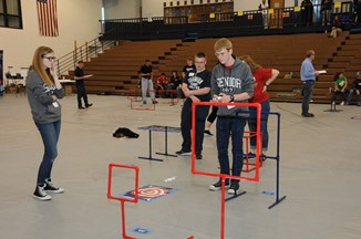 student flying drones through course