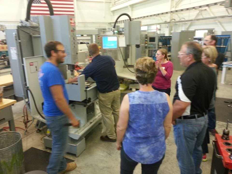 Teachers learning CNC milling machine