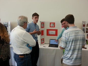 BIZCOM Participants discuss product at Semi-Finals