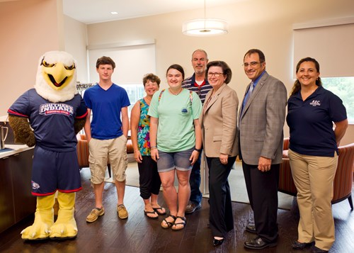 Phelps family with Archie, President Bennett, Zane Mitchell and Daniela Vidal