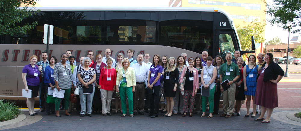 Faculty in front of the bus