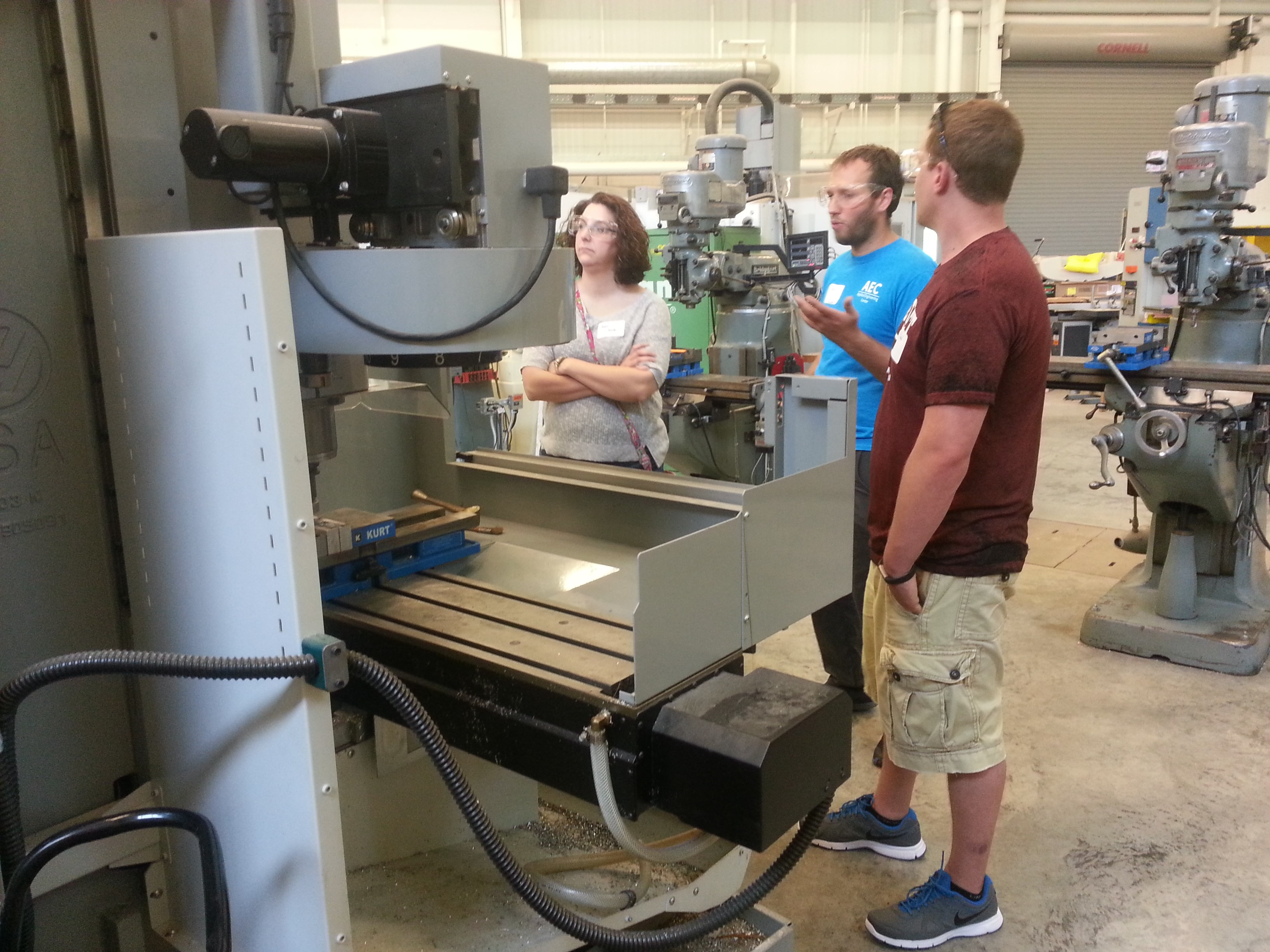 teachers working CNC milling machine