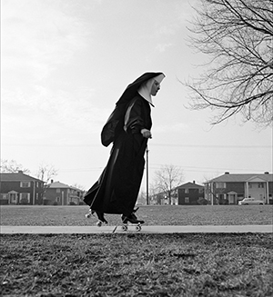 Photo of nun on sidewalk, skating