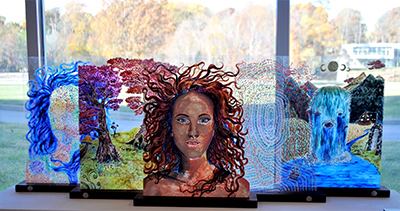 Paintings on flexiglass representing a figure in various abstract forms