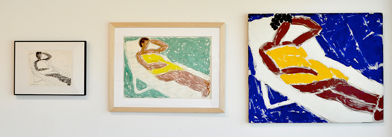 Three pieces: first a framed ink sketch, second a small framed painting, then a larger painting of a figure laying in yellow on a white lounge and a blue background