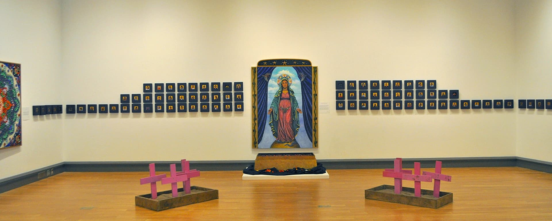 View of McCutchan/Pace gallery, with Kahlo's work on display, with red crosses on the floor
