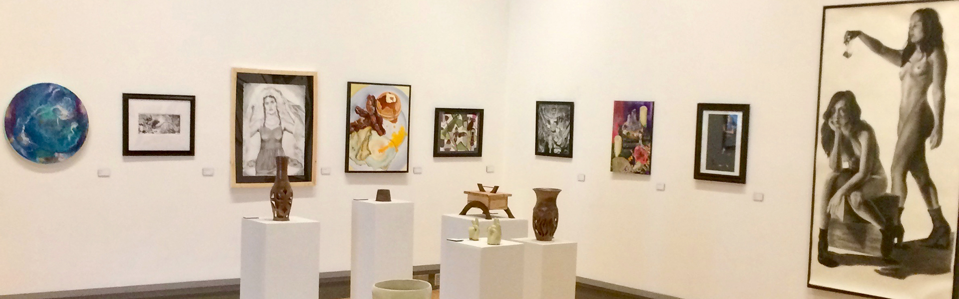 View of McCutchan/Pace gallery, with student art pieces on display such as painting, sculpture