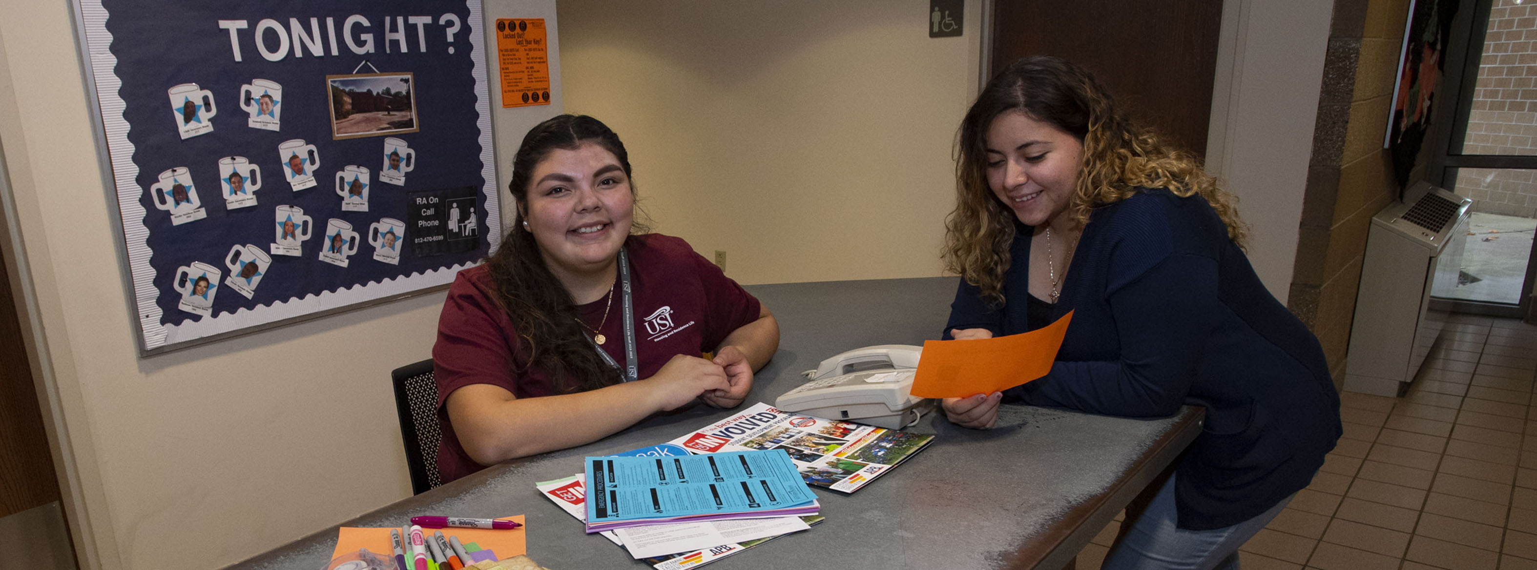 Residential Assistant and student in the Housing Office