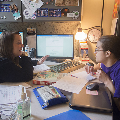 Student and counselor in counselor's office talking