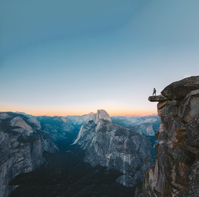 stock image of person on mountain