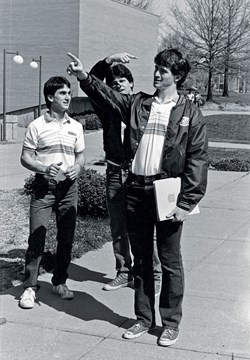 three male students acting funny