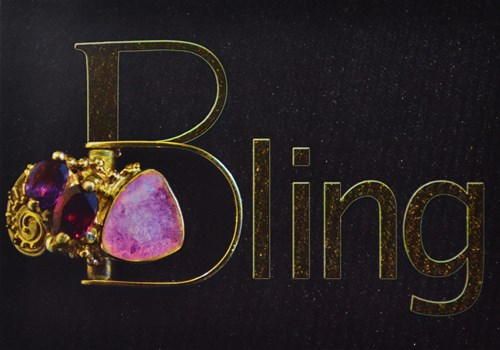 The word Bling with pink and red stone jewelry