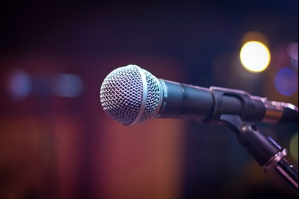 Microphone on a stand courtesy pexels.com