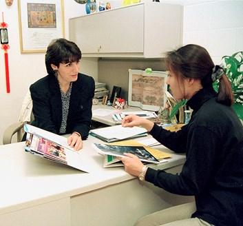 Heidi Gregori-Gahan talks to a student in her office