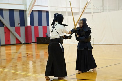 Erina Tamura and another participant demonstrate Kendo