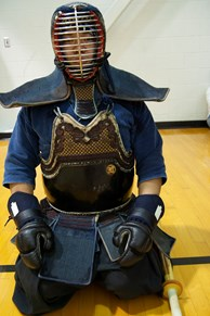 A participant at the Kendo demonstration wearing protective armor