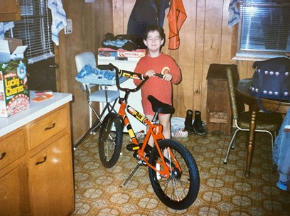 Dr. Zachary Ward with his new bike as a young boy